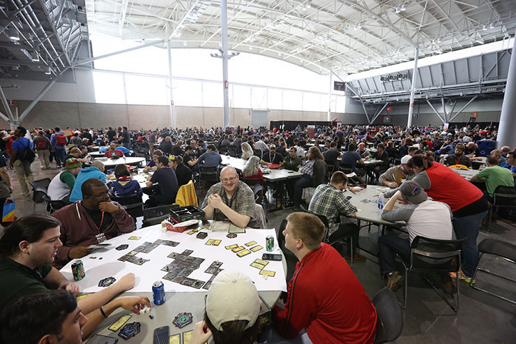 Photo of room filled of people playing board games at Pax East