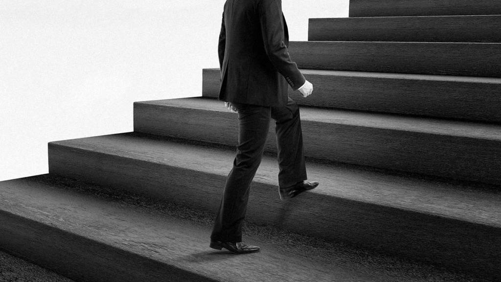 CMO walking up flight of stairs